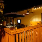 Looks like a nice patio for dinner. TV and a heater when needed.