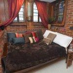 Apt: Full-size futon located in semi-private niche in living room