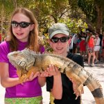 Kids Posing with Iguana at the Bazaar