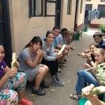 Enjoying sugarcane in the courtyard