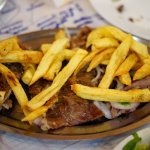 roasted goat with french fries