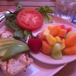 Mahi Mahi Sandwich with fruit salad side.  Delicious food, reasonable prices.  Great view of bea