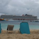 A non-zoomed in on shot of a cruise ship departing the Nassau Harbor at the end of the day.