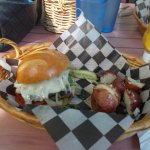 Buffalo wine burger - loaded with cheese, finely sliced and grilled onions, lettuce and tomato.