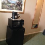 tiny fridge, microwave and & coffee maker in room