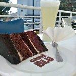 Refreshing homemade Lemonade and a slice of Chocolate and Red Velvet cake.