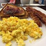 Raja's scrambled eggs, bacon and toast
