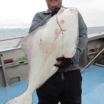 My son with a 50# Halibut