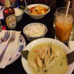 Vegan dishes green curry and massaman curry, thai iced tea and Beerlao