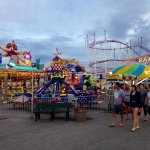 Carnival rides in the beachfront amusement park