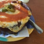 DJ's exceptionally hot jalapeño chilli topped with cheese and onions