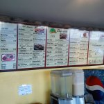 Wall menu. Choose, then order at the windo.