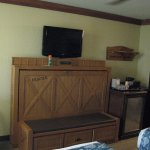Pull-down twin bed. Ample drawer space. 'fridge