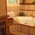 Camelot- The perfect setting to snuggle in the double Jacuzzi and watch the fireplace.