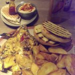 Peri Peri chicken with Garlic Bread and Potato Wedges. Hummus with spicy sauce and Beef Burger.