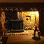 Old fire place and wood burner in the Bar.