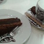 cappuccino and a piece of pralines cake
