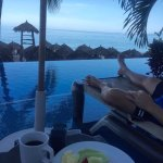 Breakfast and view of the beach from swim up pool room .