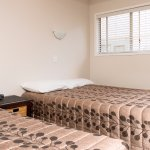 Double and Single bed in bedroom of Family unit