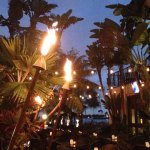 This picture was taken on the outside patio just as the tiki torches were lit simply beautifuk