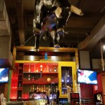 Bar with Hanging Bull Above