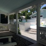 Front porch of the cottage - steps from the private pool