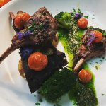Grilled lamb cutlets, braised lamb ribs, blistered tomatoes, basil puree