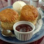 Cream tea - two scones with cream and jam.