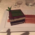 """The Grasshopper' a sort of opera cake with a green thing on top- not crushed grasshoppers =- ho"
