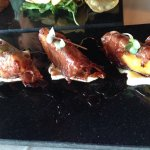 Prosciutto wrapped grilled peaches