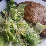 Plate lunch special - prime rib with gravy (white rice underneath) and caesar salad