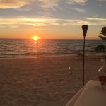 Beautiful sunset while enjoying our private beach diner