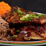 Signature Jerk Chicken and Ribs Combo Plate!