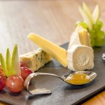 Selection of cheeses with fig jam and truffle honey