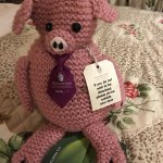 The Do Not Disturb sign is a crocheted pig
