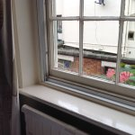 Room 110 old double glazing frame with glazing panel removed