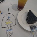 Delicious death choc cake, pineapple mint tea and some crayon drawings on table while waiting...