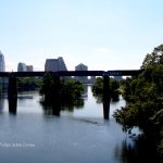 View of old railroad bridge and downtown Austin via Pedestrian/Bike Bridge.