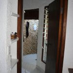 View from bedroom to bathroom, with outdoor shower