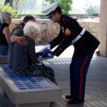 Presenting the flag to the widow.