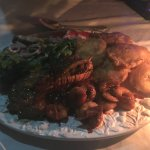 Delicious sea food platter with lobster, shrimp and catch of the day (sea bass), with tostones