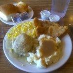 Catfish, mashed potatoes and gravy, creamed corn, and cornbread dressing