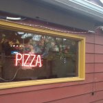Our famous neon PIZZA sign in the window visible from Main Street
