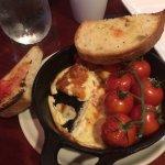 Charred tomatoes were part of the dark porridge that is called parmesan porridge or Tomato Brusc