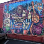 Yes, there's a parking lot! And a mural adjacent to it pointing the way to Holman's