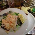 A prawn salad 'starter' dish with fresh bread about half a loaf.