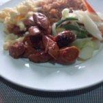 breakfast- sausage, scrambled eggs, jollof rice & salad