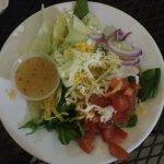 Warm soft pretzels with dip options; side house salad; Cuban sandwich