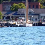 "Seneca Harbor Station with schooner ""True Love"" in foreground."