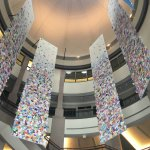 The entrance of the Bullock Museum has beautiful hanging  panels filled with butterflies.
